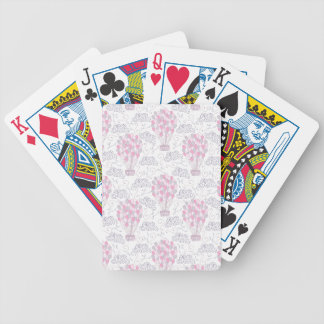 Hot air balloon with party balloons in pink bicycle playing cards