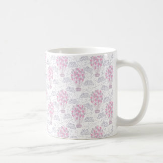 Hot air balloon with party balloons in pink coffee mug