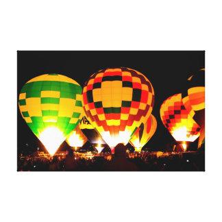 Hot Air Balloons Glowing at Night Canvas Print
