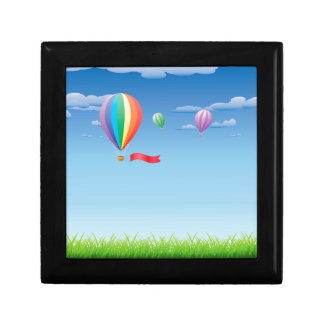 Hot air balloons over grass field small square gift box