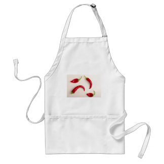 Hot chili peppers on a light wooden board standard apron