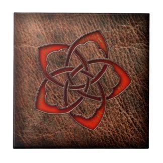 Hot orange celtic flower on leather small square tile