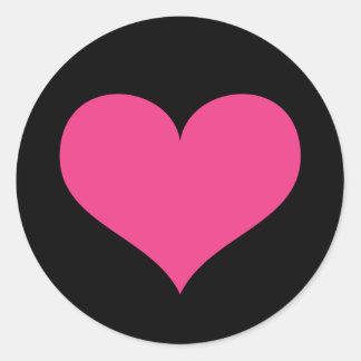 Hot pink heart on black love or Valentines day Round Sticker
