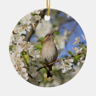 House sparrow and spring blossoms round ceramic decoration
