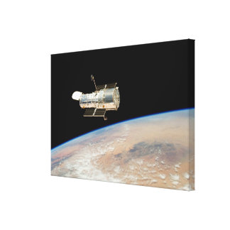 Hubble over Earth Stretched Canvas Print