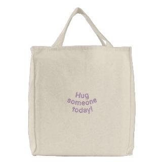 Hug someone today embroidered tote bag