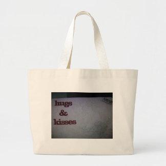 Hugs and kisses tote bag