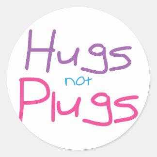 Hugs not Plugs (Pink) Round Sticker