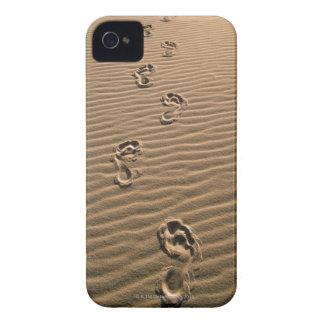 Human footprints on sandy beach iPhone 4 case