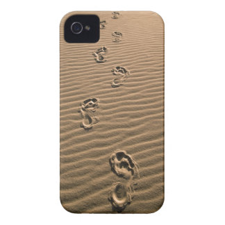 Human footprints on sandy beach iPhone 4 covers