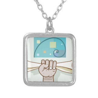 Human hand holds a paper roll secret article silver plated necklace