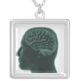 Human head in profile showing the brain silver plated necklace