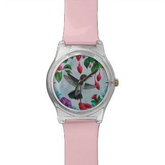 Hummingbird Flying in Flower Garden Watch
