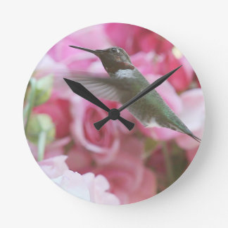 Hummingbird in pink spring flowers round clock