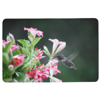 Hummingbird in red and white flowers floor mat
