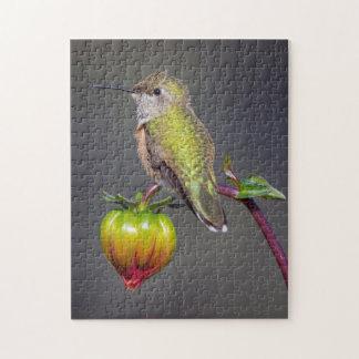Hummingbird rests on flower bud jigsaw puzzle