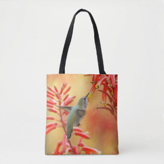 Hummingbird surrounded by red yucca tote bag