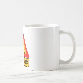 Humorous men at work sign coffee mug
