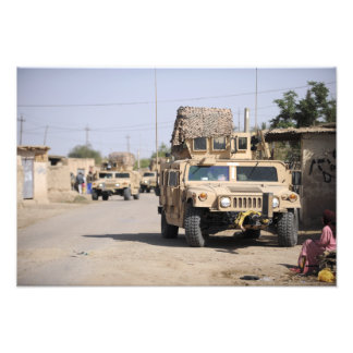 Humvee's conduct security during a patrol photo print