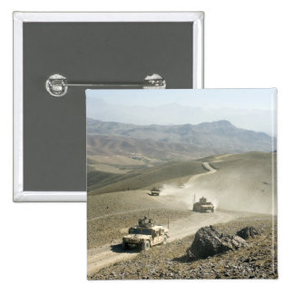 Humvees traverse rugged mountain roads 15 cm square badge