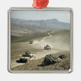 Humvees traverse rugged mountain roads christmas ornament