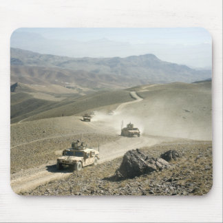 Humvees traverse rugged mountain roads mouse mat