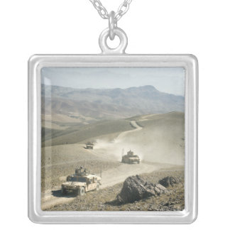 Humvees traverse rugged mountain roads silver plated necklace