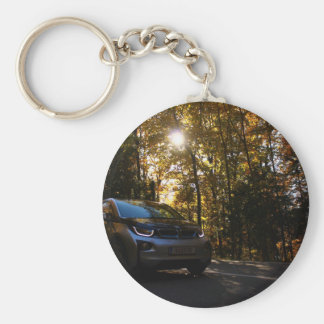 Hybrid car on a highway basic round button keychain