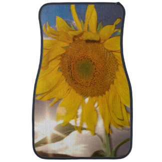 Hybrid sunflower blowing in the wind at dusk car mat