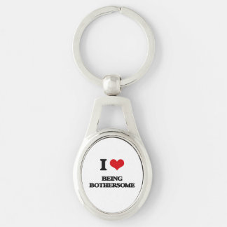 I Love Being Bothersome Silver-Colored Oval Metal Keychain
