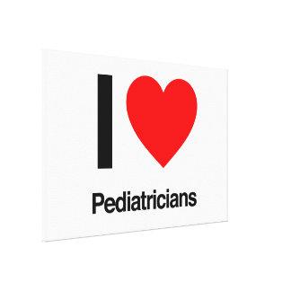 i love pediatricians stretched canvas prints