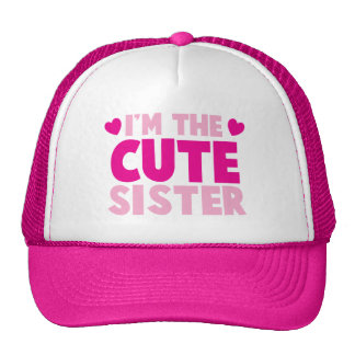 I m the CUTE sister Trucker Hats