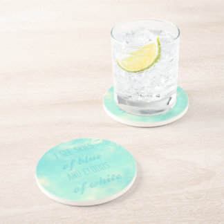 I see skies of blue and clouds of white drink coasters