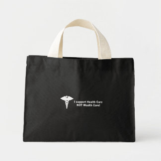 I support health care not wealth care canvas bag