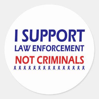 I support law enforcement not criminals round sticker