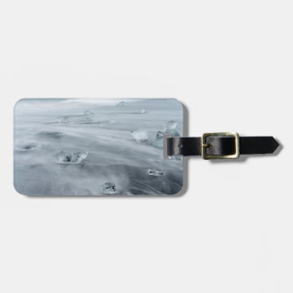 Ice and water on a beach, iceland luggage tag