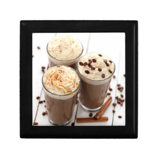 Ice coffee with whipped cream and coffee beans gift box
