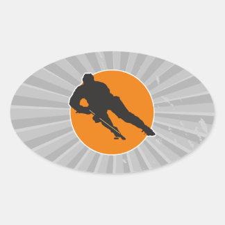 ice hockey silhouette orange circle design oval sticker