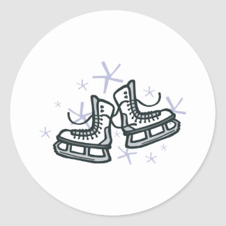 ice skates and snowflakes graphic round sticker