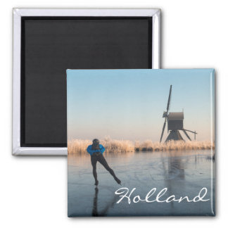 Ice skating past windmill and reeds text magnet