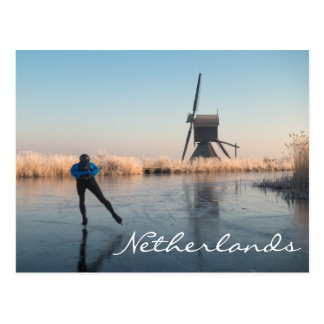 Ice skating past windmill and reeds text postcard
