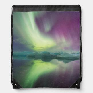 Iceland, Jokulsarlon. Aurora Lights Reflect Drawstring Backpacks