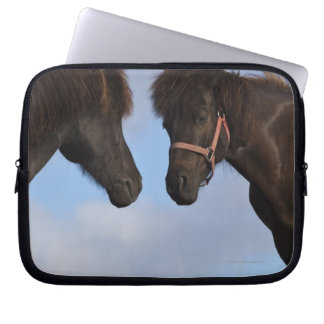 Icelandic horses facing each other laptop sleeve