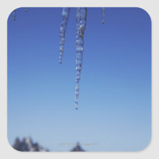 Icicles and snow-covered mountains square sticker