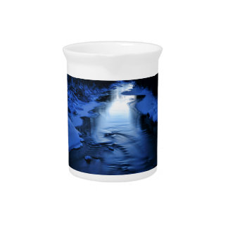 Icy and snowy river with winter blue beverage pitcher