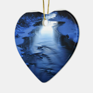 Icy and snowy river with winter blue christmas ornament