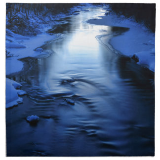 Icy and snowy river with winter blue napkin