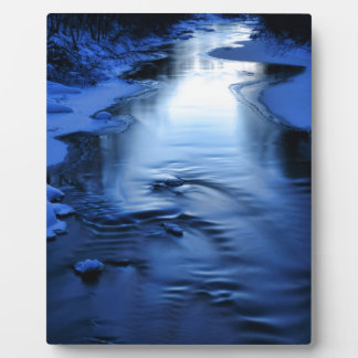 Icy and snowy river with winter blue photo plaques
