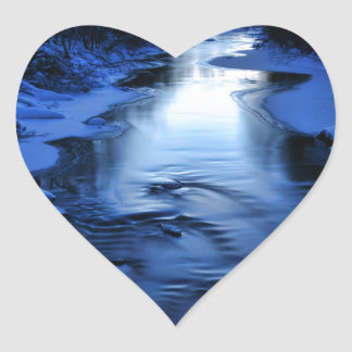 Icy and snowy river with winter blue heart sticker