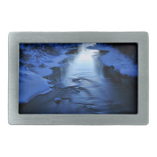 Icy blue river on cold winter evening belt buckle